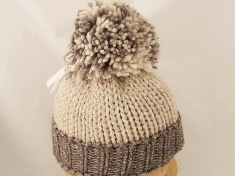 Melegari Beanie hat with pompom Walle